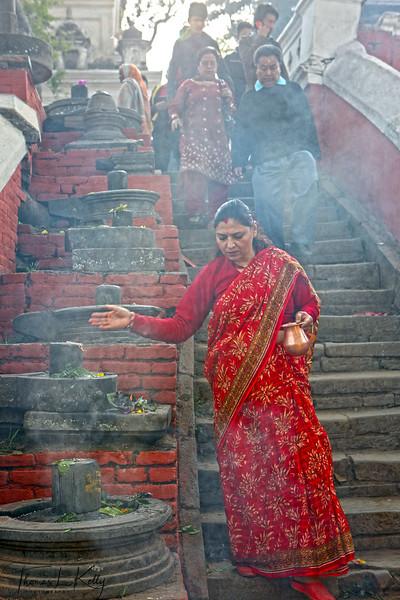 Hindu pilgrims worshiping Shiva Lingam during Maha Shiva Ratri.  Pashupatinath temple, Kathmandu, Nepal.