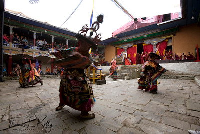 Ser Kem is first cham dances of Mani Rimdu festival. The six dancers represent Ngag-pa, Tantric magicians, who make offerings from silver chalices of alcohol and small tormas to Lama, Yidim, and Khandro; also to the shi-dak, the earth deities. A Buddhist practitioner takes 'refuge' in the Lama, Yidim, and Khandro, that is, his spiritual, guide, his personal deity, and the Wisdom Dakinis. A central theme of Buddhist practice is to make offering to these so they will help with the virtuous actions which lead to Buddhahood. Chiwong Monastery, Solu Khumbu, Nepal.