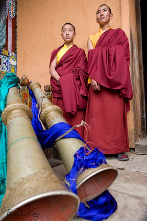 Monks in the Chiwong monastery blow long copper trumpets called Zang Dung that marks the beginning of Mani Rimdu festival.  Solu Khumbu, Nepal.