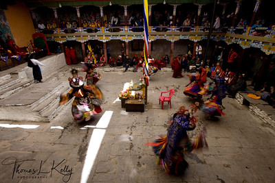 Ser Kem is first cham dances of Mani Rimdu festival. The six dancers represent Ngag-pa, Tantric magicians, who make offerings from silver chalices of alchohal and small tormas to Lama, Yidim, and Khandro; also to the shi-dak, the earth deities. A Buddhist practitioner takes 'refuge' in the Lama, Yidim, and Khandro, that is, his spiritual, guide, his personal deity, and the Wisdom Dakinis. A central theme of Buddhist practice is to make offerings to these so they will help with the virtuous actions, which lead to Buddha hood. Chiwong Monastery, Solu Khumbu, Nepal.   (Torma is a ritual cake, usually hand-molded from butter and barley flour, and it is painted.)