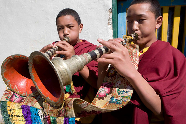 Monks in the Chiwong monastery blow double-reed instrument called Gyaling that marks the beginning of Mani Rimdu festival.  Solu Khumbu, Nepal.