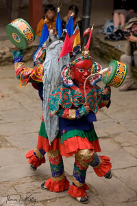 The four dancers, the Ghing, are servants of Guru rinpoche connected with his emanation as Dorje Trollo. They ahe come from his Pure Land of Sangdok Pelri where they live within his mandala, They herald and imminent arrival of Guru rinpoche at the Mani Rimdu. Two of the Ghing are male, and carry cymbals, which the two females represent wisdom.  Chiwong Monastery, Solu Khumbu, Nepal.