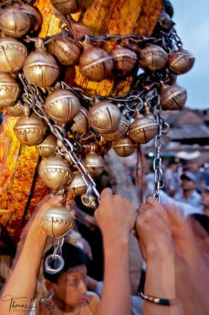 Newar devotees tying bells around a four wheeled chariot for Rato Machendranath festival. Kathmandu, Nepal.