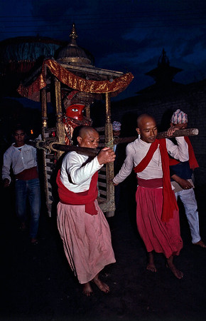 Newar priest carry Rato Macchendranath deity on a palanquin.Patan, Nepal.