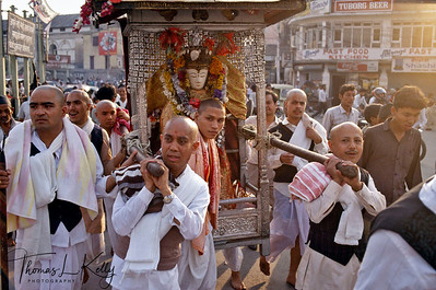 Seto Macchendranath is a white-faced state whose style is believed to have been derived from the Kings of Lichhavi Dynasty of the fourth through ninth century.  Newari priests transport the serene Seto Machhendranath idol to the rath (chariot) while hundreds of devotees offer oil lamps in Asan tol square. Kathmandu, Nepal.