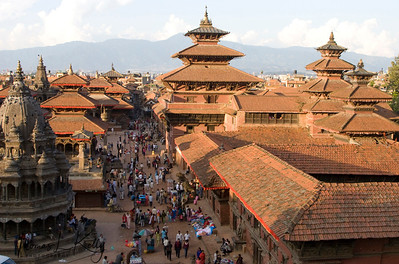 The View of the pagoda-roofed temples and the palaces (right) on Patan Durbar. The central pagoda temple is called Degutale. Nepal