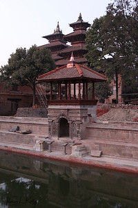 The Bhandarkal Tank behind Mul Chowk, under restoration by KVPT (Kathmandu Valley Preservation Trust). The trust restored the stone work of the tank and rebuilt a lost wooden pavilion. Patan Durbar Square. Patan, Nepal.
