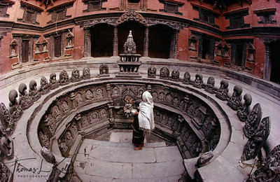 Sundari chok, in Patan's Darbar Square, was once the family residence of the Mallla King Siddhinarshigha. Tusa Hiti, the exttraordinary-worshipping bath, is in the center of the square. The octagonal form of this tank accommodates the eight Nagas, rain goddesses. Lining in the interior of the bath arfe many stone deities, including the Asta Matrika, Asta Bhairab and Asta Nagas. The glided water spout shows Lord Vishnu and his wife, Laxmi, seated on their mount, the flying Garuda. Below the spout are aquatic animals, the fish, turtle, and crocodile, all representing the water, which falls from a conch shell. At the entrance to the bath is a stone slab where the King would sit, making offerings to all his favorites gods.  Lalitpur, Kathmandu, Nepal.