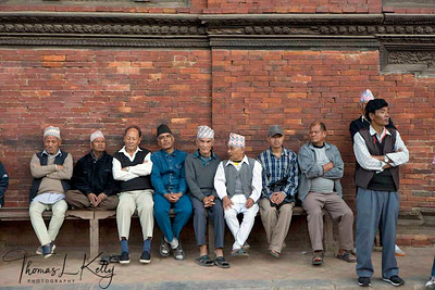 People rests in paati (shelter) at Patan Durbar Square. Paati serves as meeting and chatting place for the locals.  Lalitpur, Kathmandu, Nepal.