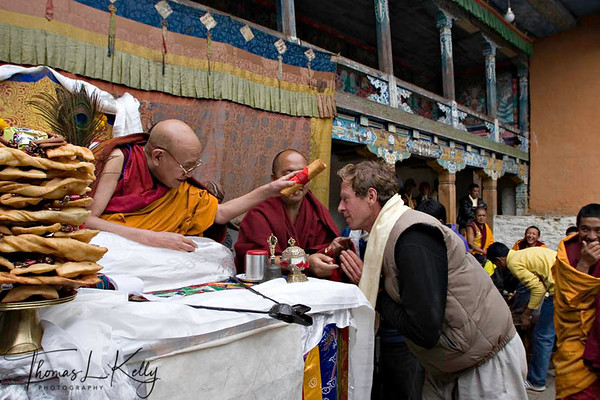 Trulshik Rinpoche blesses photographer, Thomas L. Kelly during Mani Rimdu Festival at Chiwang Monastery, Solu, Nepal.