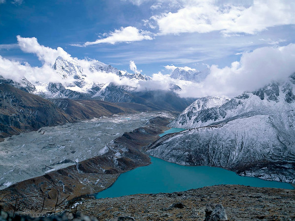 Gokyo Lake, Solukhumbu, Nepal.   Gokyo Lakes are oligotrophic lakes in Nepal's Sagarmatha National Park, located at an altitude of 4,700–5,000 m (15,400–16,000 ft) above sea level. These lakes are the world's highest freshwater lake system. It is one of the most popular tourist destinations leading towards the Sagarmatha base camp. The Gokyo Lakes are considered sacred by both Hindus and Buddhists. Hindus take a holy bath in the lakes during the Janai Purnima festival, which usually occurs in the month of August.