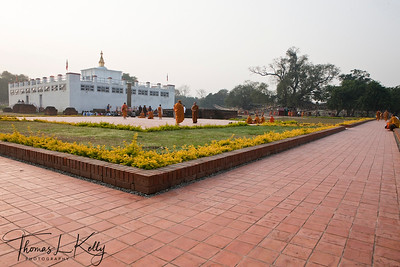 The famous Mayadevi Temple in Lumbini. Inside the temple is a marker stone, said to mark the exact birthplace of Buddha. The pond in front of the temple is said to be the place where Mayadevi bathed before she went into labour. Nepal.