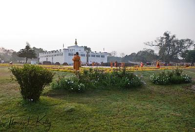 Thai monks circumamabulate Mayadevi temple. Lumbini, Nepal.