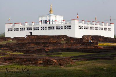 Ruins of ancient monasteries and stupa in front of the Mayadevi Temple in Lumbini. Inside the temple is a marker stone, said to mark the exact birthplace of Buddha. Nepal.