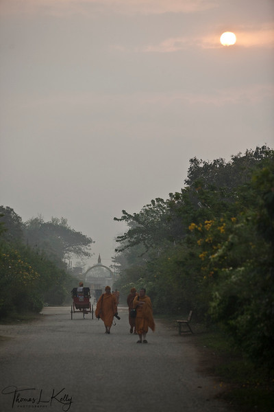 Buddhist pilgrims and monks from various denominations walk to Mayadevi Temple for early morning prayer. Lumbini, Nepal.