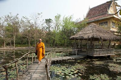 Thai monk at lotus pond near Royal Thai Monastery in Lumbini. Nepal.