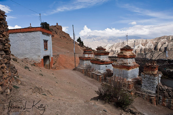 Entrance passagway with chortens to the village in Samar. Mustang, Nepal.