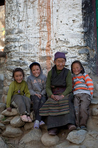 Mustangi women with her grand children wears traditional attire. Ghemi village in Mustang, Nepal.