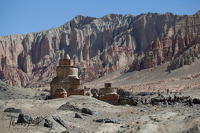 Heading towards Lo Ghekar from Ghemi village. One can witness magnificent mani walls and chortens with the backdrop of red rock formations. Mustang, Nepal.