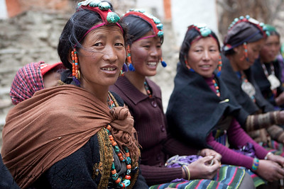 "Women wear traditional head dresses called ""Perak"" for special occasions such as wedding and festivals. Lo Ghyekar Goempa, Mustang, Nepal."