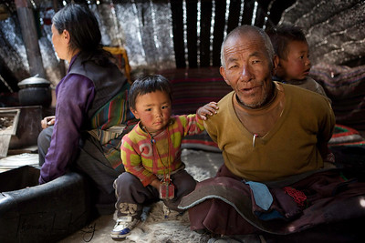 Nomad family inside their yak hair tent.  Samduling (4090m). Mustang, Nepal.