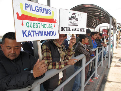 Receivers from hotels wait outside Tribhuwan International Airport for their guest with signboard, on the vehicle strike day called by Congress on Dec-19-2011. Kathamandu, Nepal.