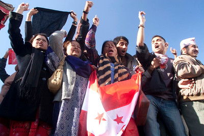 Activists of agitating 'Nepali Congress Party' alliance, holding their flags defying prohibited orders and demostrating, at Hanuman Dhoka Complex, in Jan-21-2006.  Basantapur Durbar Square, Kathmandu, Nepal.