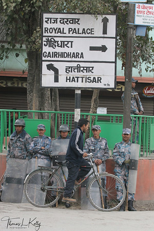 Nepalese Armed Police force keeping watch nearby Kathmandu's Royal Palace.