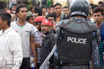 Nepal Police force played vital role to forbid any unfortunate clashes between the maoists and Peace Meet attenders.  Thousands of Nepalese flock to attend peace meet at Basantapur Durbar Square to urge the Nepal Political parties and the Maoist to forge consensus and draft the statute on time to restore peace throughout the Nation. Nepalese are experiencing strike for the 7 days now, since the May day. New Road, Kathmandu, Nepal. 2010-May-07