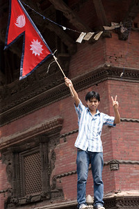 Nepal's National flag is fluttered to welcome thousands of Nepalese to attend peace meet at Basantapur Durbar Square to urge the Nepal Political parties and the Maoist to forge consensus and draft the statute on time to restore peace throughout the Nation. Nepalese are experiencing strike for the 7 days now, since the May day. New Road, Kathmandu, Nepal. 2010-May-07