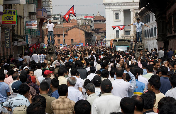 Thousands of Nepalese flock, fluttering Nepalese National flag, to attend peace meet at Basantapur Durbar Square to urge the Nepal Political parties and the Maoist to forge consensus and draft the statute on time to restore peace throughout the Nation. Nepalese are experiencing strike for the 7 days now, since the May day. New Road, Kathmandu, Nepal. 2010-May-07