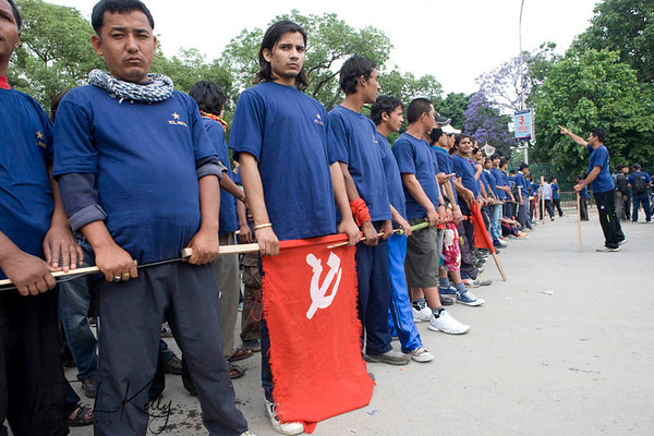 Maoist and YCL (Youth Communist League) display their flag, while they tried to intercede in the Peace Rally organized by 48 organisations including Federation of Nepalese Chambers of Commerce and Industries (FNCCI), Nepal Chamber of Commerce, Professional's Alliance for Peace and Democracy (PAPAD) and Hotel Association of Nepal (HAN)   Thousands of Nepalese flock to attend peace meet at Basantapur Durbar Square to urge the Nepal Political parties and the Maoist to forge consensus and draft the statute on time to restore peace throughout the Nation. Nepalese are experiencing strike for the 7 days now, since the May day. New Road, Kathmandu, Nepal. 2010-May-07