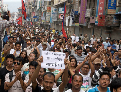 Thousands of Nepalese flock to attend peace meet at Basantapur Durbar Square to urge the Nepal Political parties and the Maoist to forge consensus and draft the statute on time to restore peace throughout the Nation. Nepalese are experiencing strike for the 7 days now, since the May day. New Road, Kathmandu, Nepal. 2010-May-07