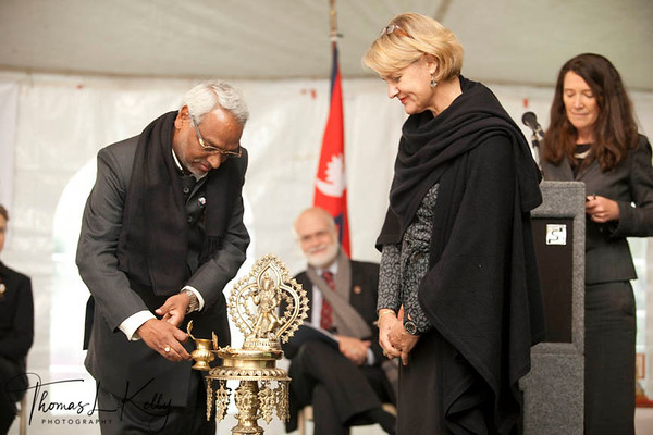 Hon'ble Minister of Health and Population, Rajendra Mahato lit ceremonial lamp during the re-launch meeting of Peace Corps in Nepal at Kamal Kunj in Kamaladi. Standing on the right is Andra Wojnar Diagne, the Nepal Director for Peace Corps. Kathmandu, Nepal.