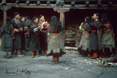 Bhotia wedding ceremony. Tea and Beer servers await  bridal party outside the Halje village monastery.  Humal, Nepal.