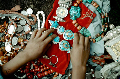 Young sister's of the grooms' play dress-up with elaborate turquoise earrings worn on ceremonial occasions.