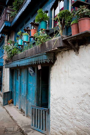 Stone masonry house of Ang Babu, one of the wealthiest Sherpas in Solu Khumbu. Nepal. All the houses in Solukhumbu are designed and hand constructed by local Sherpas.  They carve wooden windows and paint it in holy colours.