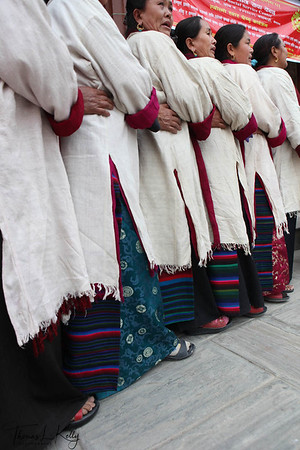 Sherpas performing their traditional dance at Hyolmo Monastery. Kathmandu, Nepal. Sherpa women wear traditional attire called tongkok with colourful striped apron tied from waist called pangden. Married Sherpa women tie pangden whereas unmarried Sherpa women just wear tongkok.