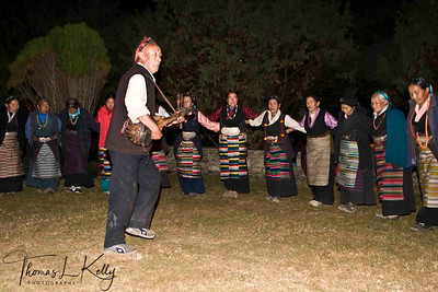 Sherpas performing their traditional dance at Hotel Del'Sherpa. Solu Khumbu, Nepal. Sherpa women wear traditional attire called tongkok with colourful striped apron tied from waist called pangden. Married Sherpa women tie pangden whereas unmarried Sherpa women just wear tongkok.