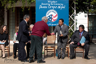 "Jesse Brandt gifts Peace Corps CD of ""Music for Peace"" to Finance Minister Barsha Man Pun.  50th Anniversary Swearing In of Peace Corps Nepal Volunteer Group 199."