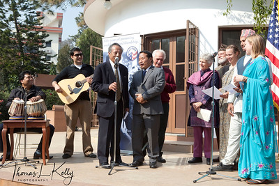 Singha B. Basnyet, Ph.D and Finance Minister Barsha Man Pun sing Peace Corps song with newly trained volunteers.  50th Anniversary Swearing In of Peace Corps Nepal Volunteer Group 199.