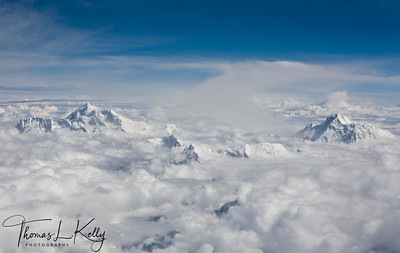 Aerial view of Mt. Everest (left) and Mt. Kanchanjunga peaking out of clouds, on the way to Lhasa from Kathmandu.