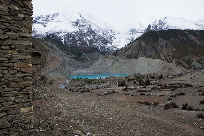 Glacial lake created by Mt. Gangapurna, with fallow fields where winter wheat will be planted that will be harvested in April/May.
