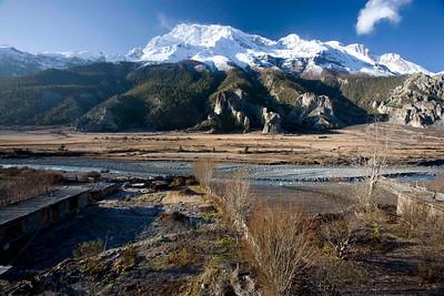 Beautiful yarshagumba field with Mt. Annapurna. Looking west from Hotel New Yak. Braaga village. Manang, Nepal.