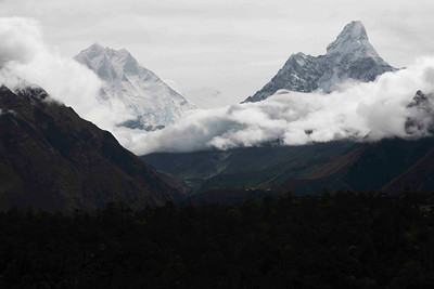Mt. Amadablam on the right rises above the cloud. View from Lukla. Nepal.