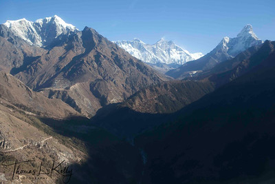 Mt. Everest in the centerd by Lhotse and Nupse wall with Mt. Amadablam on the extremee right, dwarfs Namche Bazar. Lukla, Nepal.
