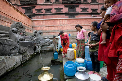 Residents in and around Patan Durbar Square have to stand in queue for more than 3 hours to get 20 liters of drinking water from traditional water hitis.    Patan Durbar Square, Nepal.