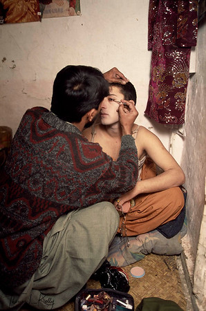 Hijras entertainers getting made up before a dancing engagement for a wedding reception, Peshawar.