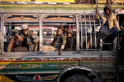 Young boys, many of who are Afghan refugees, clean buses and perform other services for the drivers who take them on as assistants. Some boys, as young as 8 complain of sexual harassment.