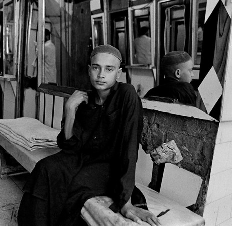 A bathhouse boy waits for client. Peshawar, Pakistan.